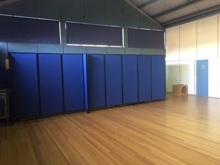 Hiding Unsightly Storage in a School Gym Using Portable Partitions