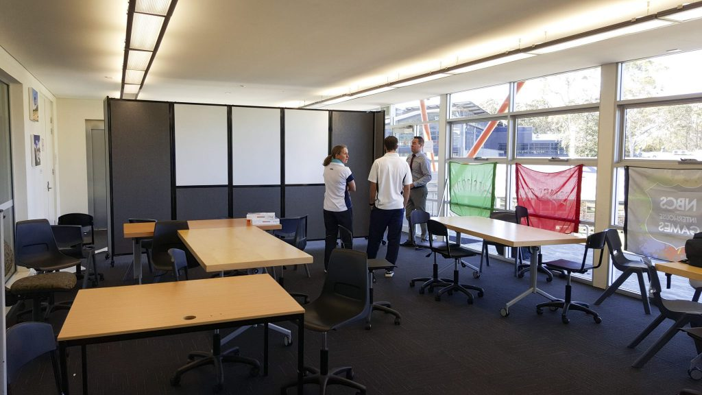 Mobile Whiteboard integrated into a folding classroom divider on wheels- portable partition