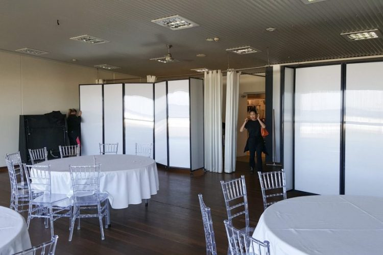 Creating a temporary corridor through a function area from kitchen to cafe- portable partition