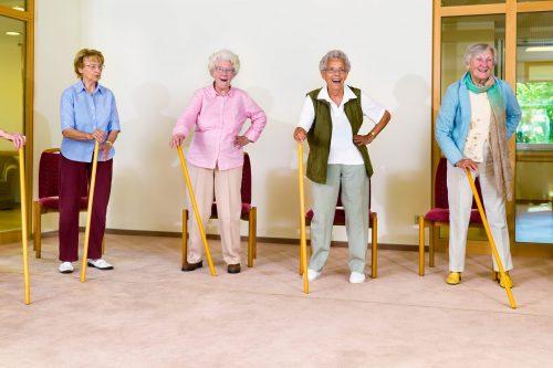 Happy healthy elderly woman in healthcare space- portable partition
