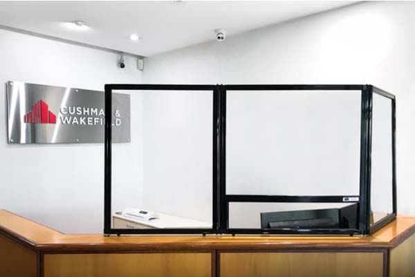 Reception sneeze guard for safer customer service interactions at Cushman & Wakefield office